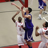 Danvers foward George Merry (32) blocks the shot of Salem guard Christian Dunston. David Le/Salem News