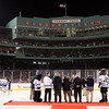 The ceremonial puck drop at the start of UNH and UMaine's Frozen Fenway game on Saturday night. David Le/Salem News