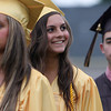 Bishop Fenwick graduate Jessica Patnaude smiles up at her family while marching into her graduation ceremony on Friday evening. David Le/Staff Photo