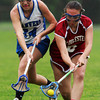 Danvers sophomore Katherine Leonard, left, and Gloucester's Sara Sidlowski, right, battle for a loose ball on Tuesday afternoon. David Le/Staff Photo