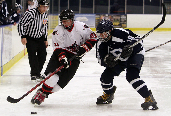Peabody's Mike Vadala (19) right, lines up a hit on Salem puck-carrier Adam Ngo (22) left, during their game on Wednesday afternoon. David Le/Salem News