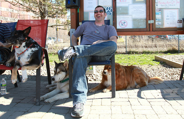 Shawn Brady, of Salem, sits with his dogs Murphy, left, Maverick, center, and Raffael, right at the Salem Dog Park on a warm March afternoon. David Le/Staff Photo