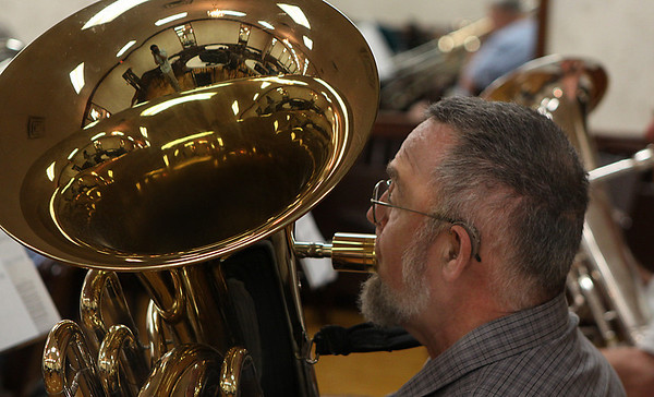 Salem: John Stewart, of Hampton, NH rehearses with the North Shore Concert Band on Tuesday evening at the Knights of Columbus music hall in Salem. The local concert band will begin a series of free family concerts beginning June 29th at the Salem Willows. Photo by David Le/Salem News