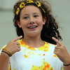 """Giana Metta, 12, of Beverly, lip synchs to """"Here Comes the Sun"""" by the Beatles during Beverly Homecoming's annual Lip Synching Competition on Tuesday evening at Lynch Park. David Le/Staff Photo"""