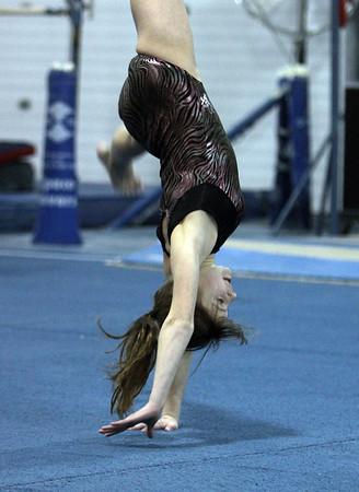 Yellowjackets gymnast Samantah Mandracchia practices flips across the floor. David Le/Staff Photo.