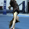 Yellowjackets gymnast Samantah Mandracchia practices flips across the floor. David Le/Staff Photo.