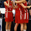 Masco head coach Bob Romeo offers some words for senior Chelsea Nason, left, while seniors Danielle Davis, center, and Brooke Stewart, right, embrace follwing a loss to Andover in the D1 North Final on Saturday. David Le/Staff Photo