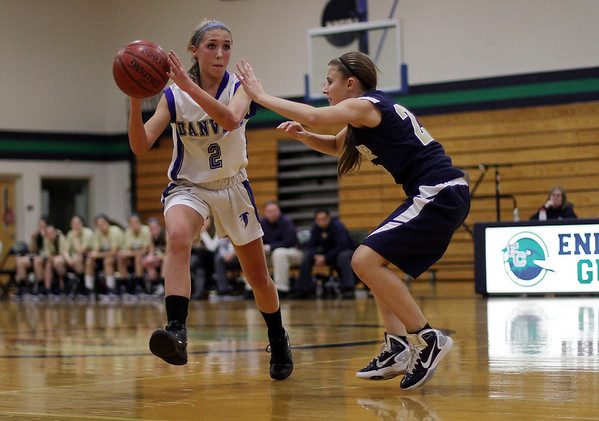 Beverly: Danvers point guard Delaney Zecha (2) passes to a teammate against Winthrop on Thursday night at Endicott College. David Le/Salem News