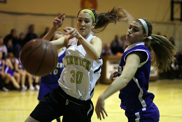 Peabody: Danvers foward Ashley Arnoldy, right, strips the ball away from Bishop Fenwick's Lauran Moulton on Wednesday night.  David Le/Salem News
