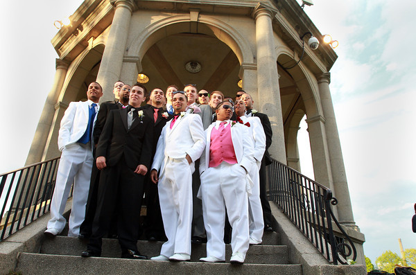 A group of Salem High School seniors stand on the steps of the Salem Common gazebo for photos before heading down to the Salem Waterfront Hotel for their senior prom on Friday evening. David Le/Staff Photo