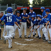 The Peabody Little League team greets Tyler MacGregor (15) at home plate following a home run against Marblehead. Peabody fell to Marblehead 10-7 in the Gallant Tournament at Forest River Park on Tuesday evening.David Le/Staff Photo