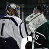 St. John's Prep senior goalie David Letarte (1) left, talks with an Austin Prep's Ryan Quinn (20), following an Eagles win. David Le/Staff Photo