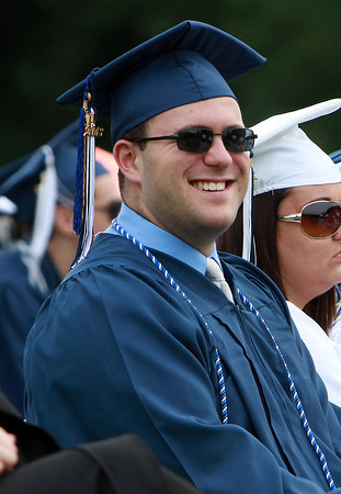 Peabody High School graduate Daniel Sherman laughs at a joke told by Peabody Mayor Ted Bettancourt on Friday evening. David Le/Staff Photo
