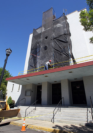 Scaffolding surrounding the crucifix on the front of St. Joseph's Church on Lafayette street in Salem while workers removed it in preparation for the building to be taken down. David Le/Staff Photo