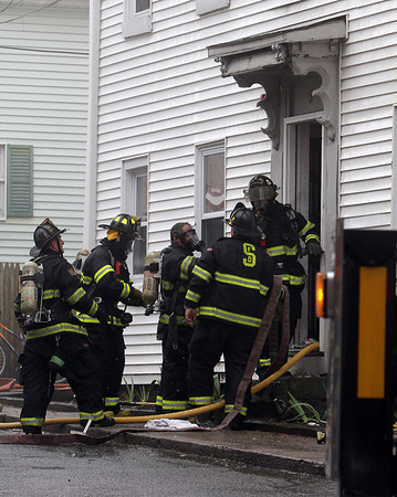 Peabody: A group of Salem and Peabody firefighters prepare to enter the building after the blaze had been extinguished. David Le/Salem News