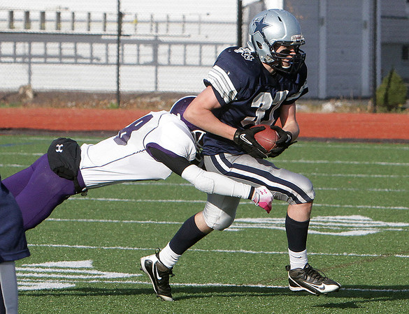 Hamilton-Wenham's Christian Ecker, right, tries to get away from a Bourne High School defender. David Le/Salem News