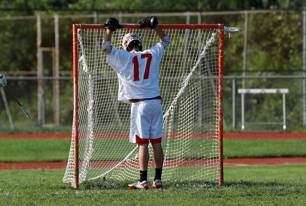 Masco defenseman Dan Werner can't bear to watch Needham celebrate a 9-8 win over the Chieftans on Wednesday afternoon. David Le/Staff Photo