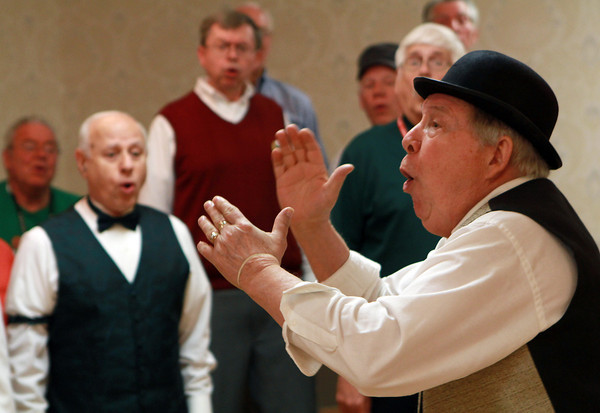Roger Dalton, a member of the Northshoremen Barbershop Chorus, leads the group of singers during rehearsal on Wednesday evening. David Le/Staff Photo