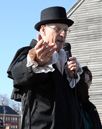 Reverend Dr. Thomas McKibbens, Senior Pastor at the First Baptist Church in Worcester, plays Adnoriam Judson, during a re-enactment of the first Christian missionaires leaving America for foreign lands on Monday afternoon at Derby Wharf in Salem. David Le/Staff Photo