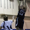 Swampscott's Niki Laskaris (23) rises over Peabody's Katie Brunelle (14) for a shot on Friday night. David Le/Salem News
