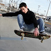 Zac Goldstein, of Beverly, does a trick on his skateboard at the skate park next to the Myles Youth Center on a warm January afternoon. David Le/Salem News.
