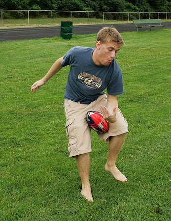Marblehead: Eric Tremblay, of Marblehead, finds himself in a dangerous position after he couldn't manage to make a one-handed catch while playing football at the Village School in Marblehead on Tuesday afternoon. Photo by David Le/Salem News