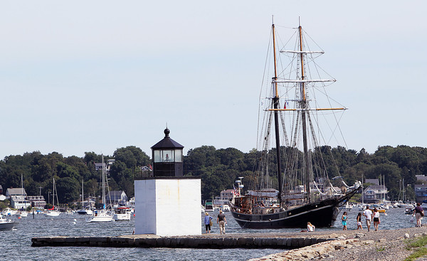 The Tallship Unicorn, an all-female crewed ship, sails slowly past the Derby Wharf Lighthouse on Tuesday afternoon as she prepared to dock at Central Wharf. The tall ship was built in 1947 in the Netherlands using recycled metal from captured German U-boats after World War II.  David Le/Staff Photo