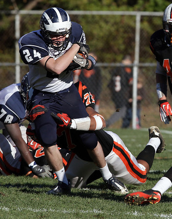 Swampscott runningback Evan Rhodes (24) tries to shake free from a Beverly defender on Saturday afternoon. David Le/Salem News