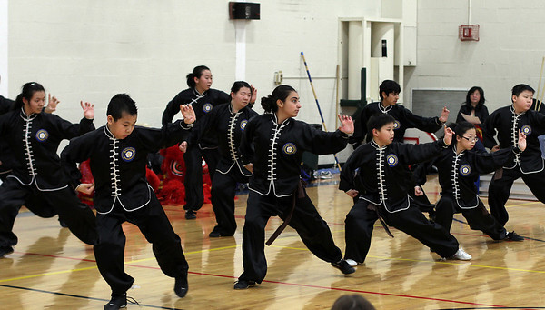 Students from Calvin Chin's Martial Arts Academy perform for a crowded gymnasium at the Hamilton-Wenham Public Library as part of the Lunar New Year Celebration. David Le/Staff Photo