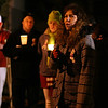 Kim Flynn, mother of former human service worker Stephanie Moulton, who was allegedly murdered by a patient last January, speaks during a candlelight vigil on Wednesday night. David Le/Salem News