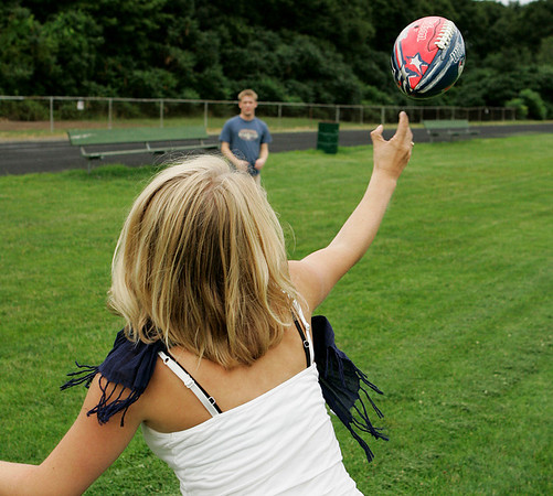 Marblehead: Kelsey Pederson, of Marblehead tosses the football to Eric Tremblay, also of Marblehead while they played catch at the Village School in Marblehead on Tuesday afternoon. Photo by David Le/Salem News