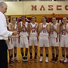 Masco head coach Bob Romeo, left, is applauded by his team after receiving an award honoring his 10 years guiding the Chieftans. David Le/Salem News