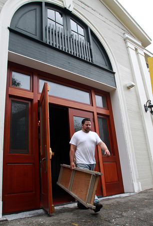 Bret Marciano, of Beverly Public Services, carries some equipment out of the Carriage House at Lynch Park after work on Wednesday afternoon. David Le/Staff Photo