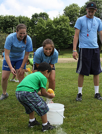 Peabody: From left, Samantha Charest, Michelle Grifoni, and Jared Ingersoll, cheer on Kindergartener Gabriel Diaz at the Welch School's Annual Field Day, held on Friday in Peabody. Photo by David Le/Salem News
