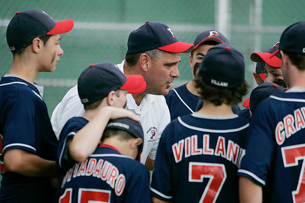 Norwood: Peabody West manager Bob Sullivan gathers his team in for one last huddle and some encouraging words after West was defeated 10-4 by Southborough in the Massachusetts Little League State Championship at Kelly Field in Norwood. Peabody's magical season and quest for its second consecutive appearance at Williamsport was ended on Sunday afternoon. Photo by David Le/Salem News