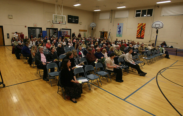 About a hundred people filled the gymnasium at Buker Elementary School in Wenham for a special  town meeting regarding the Wenham Tea House on Wednesday night. David Le/Staff Photo