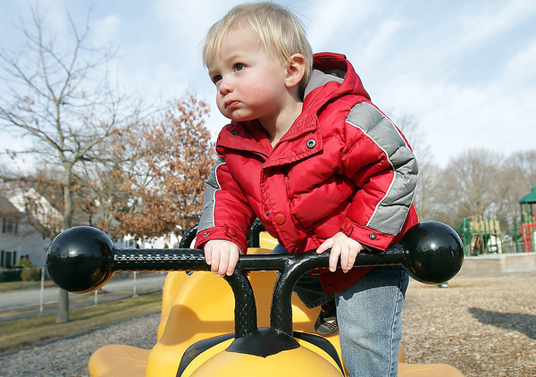 Dillon Murphy, 1, of Beverly climbs onto a playground truck at Kimball Haskell Park on a warm Tuesday afternoon. David Le/Salem News.