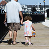 Salem: Sean and Lindsey Keough, of Salem enjoy walking along the recently completed Harborwalk in downtown Salem on Thursday afternoon. The Harborwalk runs along the South River basin from Congress Street to Layfayette Street. Photo by David Le/Salem News
