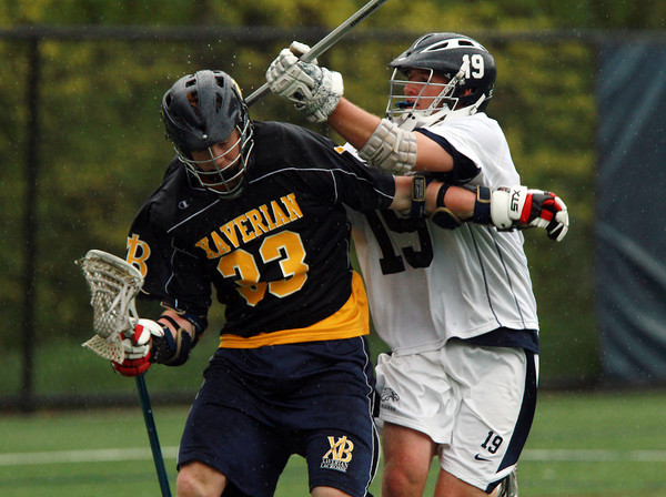 St. John's Prep defender David Letarte (19) right, defends Xaverian attacker Ryan McClellan (33) left, on Tuesday afternoon. David Le/Staff Photo