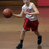 Derek McIntire dribbles into the lane on Saturday morning. David Le/Salem News