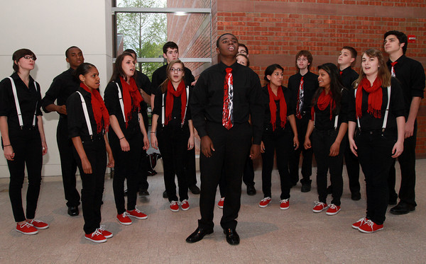 "Salem High School junior Nathaniel Oscar, center, sings a solo for ""Witch Pitch"" Salem High's a capella group, at the 100th Anniversary Celebration of the Salem Chamber of Commerce. David Le/Staff Photo"