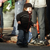 Dante Shaw, 1, of Beverly, dances along Cabot St to some live jazz music during the annual Beverly Holiday Parade. David Le/Salem News