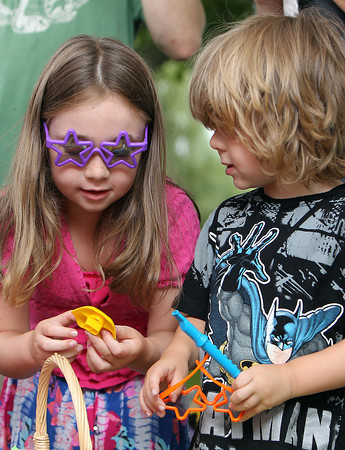 Lily Behen, 5, left, of Peabody, and her brother Christian, 4, pick through a basket of musical toys at the Salem Jazz and Soul Festival on Saturday morning. David Le/Staff Photo