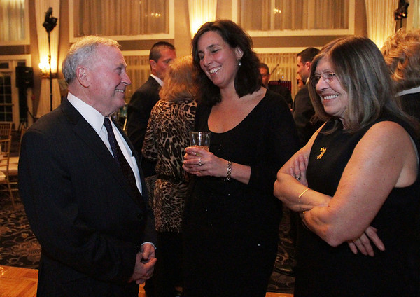 Beverly Mayor Bill Scanlon, left, chats with Miranda Gooding, center, and Irene Christ, both of Beverly, at his inaugural ball on Friday evening at Danversport Yacht Club. David Le/Salem News.
