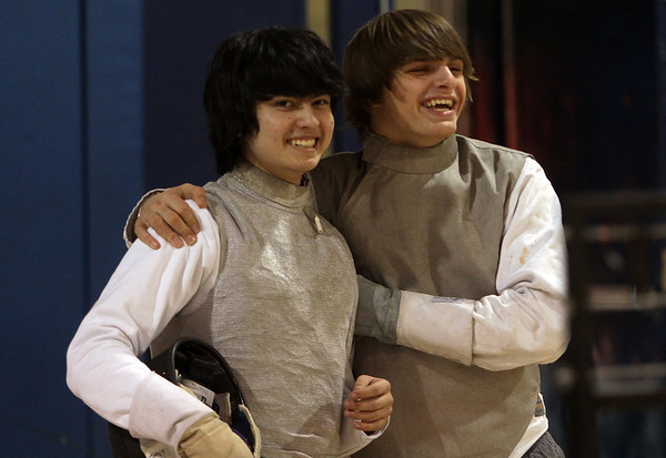 St. John's Prep senior fencers Dan Burke, left, and David Batterman, right, share a laugh as they prepare for a chance to win an 8th straight state fencing title. David Le/Salem News