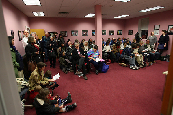 The crowd for the MBTA public hearing for the new proposed plan to increase fares and cut services spilled from the Salem City Hall Annex into an adjacent room where people packed in to listen and have their questions answered. David Le/Salem News