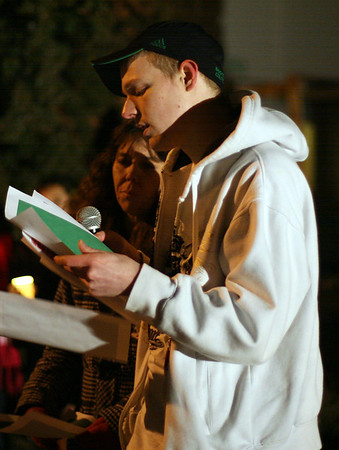 DJ Novack, cousin of Stephanie Moulton, read a poem in remembrance of his cousin at a candlelight vigil on Wednesday night. David Le/Salem News