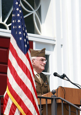 Master of Ceremonies Bruce Eaton, welcomes a large crowd gathered around Danvers Town Hall for the Memorial Day Ceremony on Monday. David Le/Staff Photo
