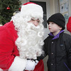 Keegan Noonan, 4, of Danvers, leans over to tell Santa what he wants for Christmas at Pope's Landing, on Saturday afternoon. David Le/Salem News