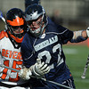 Hamilton-Wenham's Elliot Burr (22) right, carries the ball while being contested by Beverly defenseman Andrew Irving (15). David Le/Staff Photo